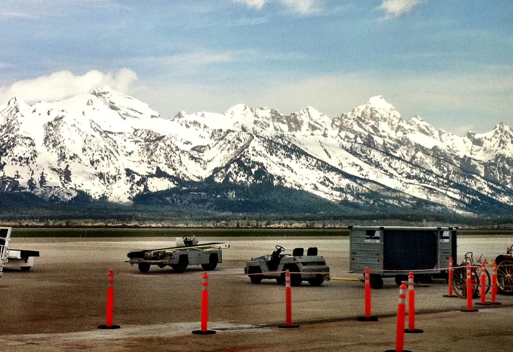 Waiting at the Jackson Hole airport to begin the trip home. View is out the waiting room window. Grand Teton peak is on the right.