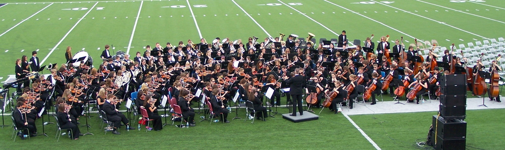 The combined Jenison High School Bands and Orchestras in performance at the JHS Commencement Ceremonies