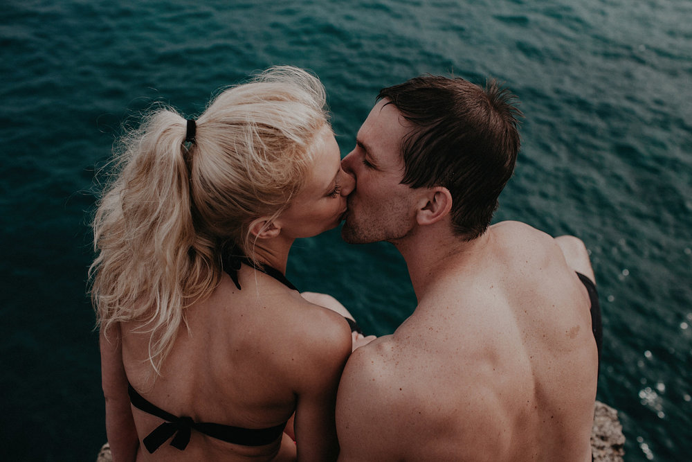 hawaii kauai elopement cliff jumping bride groom kissing photo