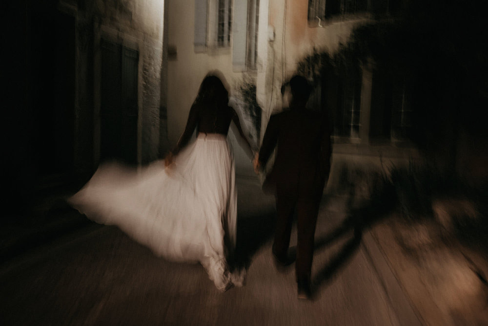goult provence france elopement vow renewal couple running street portrait photo