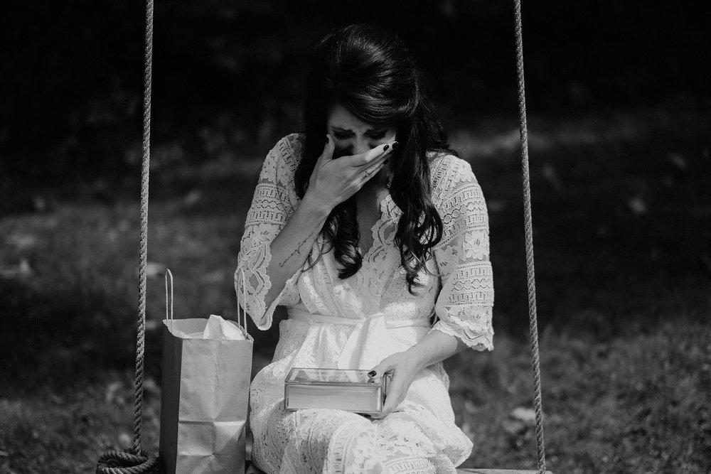 andover new jersey crossed keys estate adventure wedding photographer bride reading letter tree swing crying