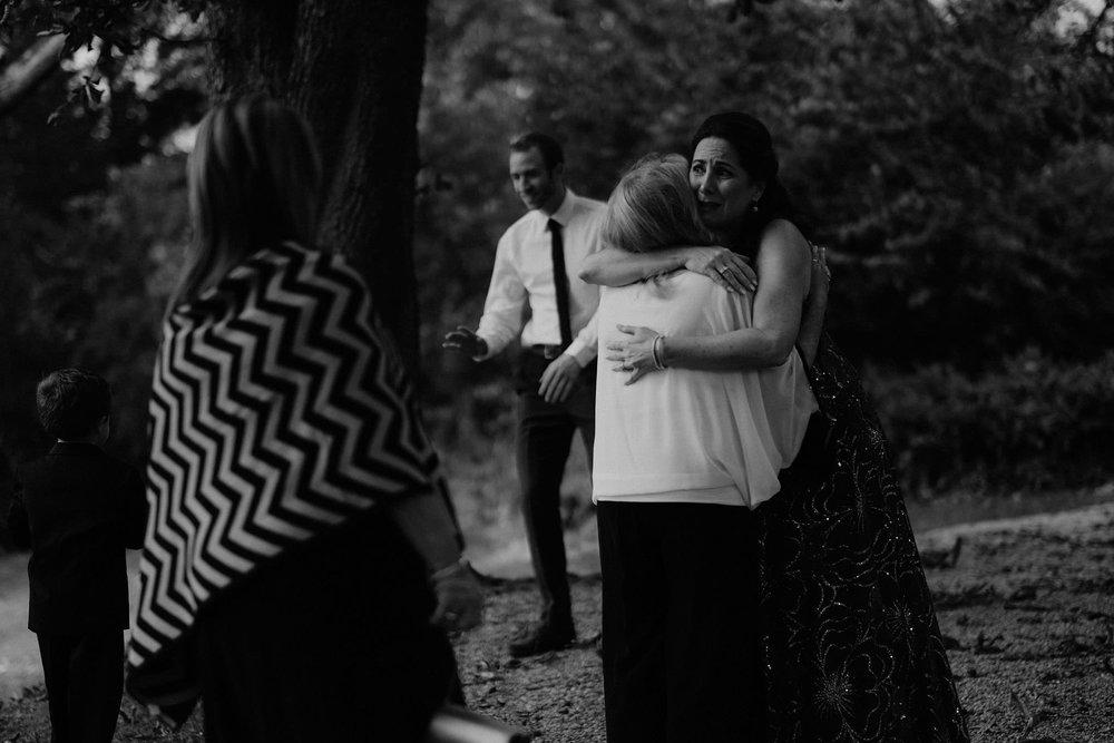 andover new jersey crossed keys estate adventure wedding photographer guests hugging