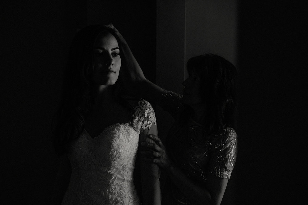 black and white bride getting ready with mom veil photo