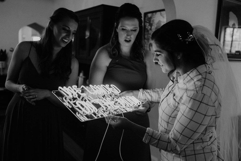 cincinnati warehouse wedding photographer bride neon sign