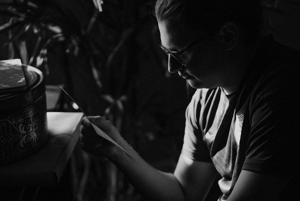 cincinnati warehouse wedding photographer groom reading letter
