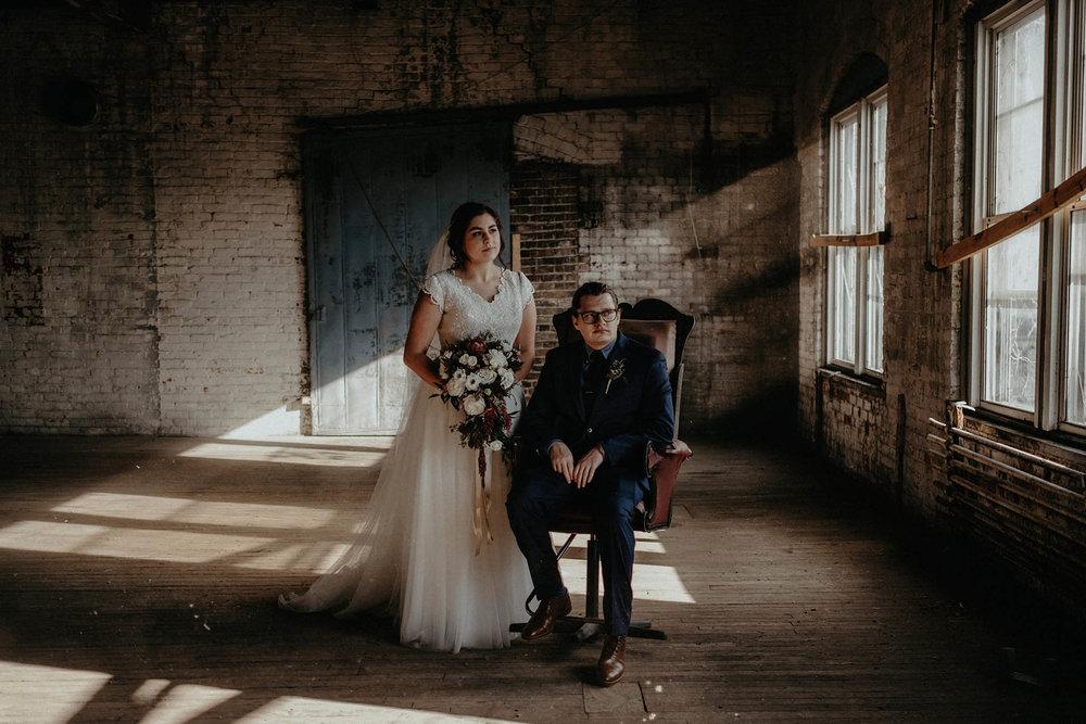 cincinnati warehouse wedding photographer bride and groom window portrait