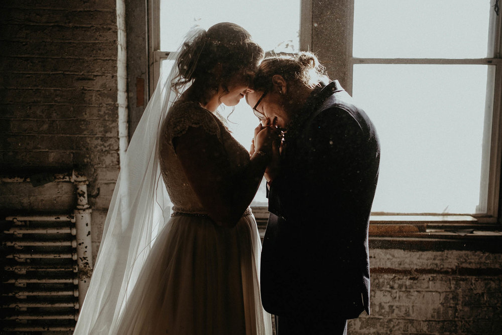 cincinnati warehouse wedding photographer bride and groom portrait dust