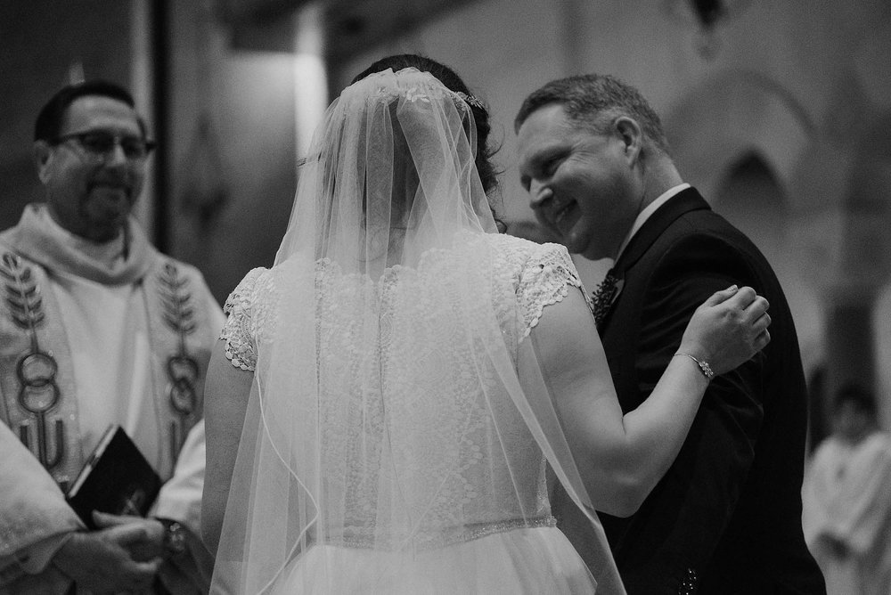 cincinnati warehouse wedding photographer cathedral church ceremony father smiling