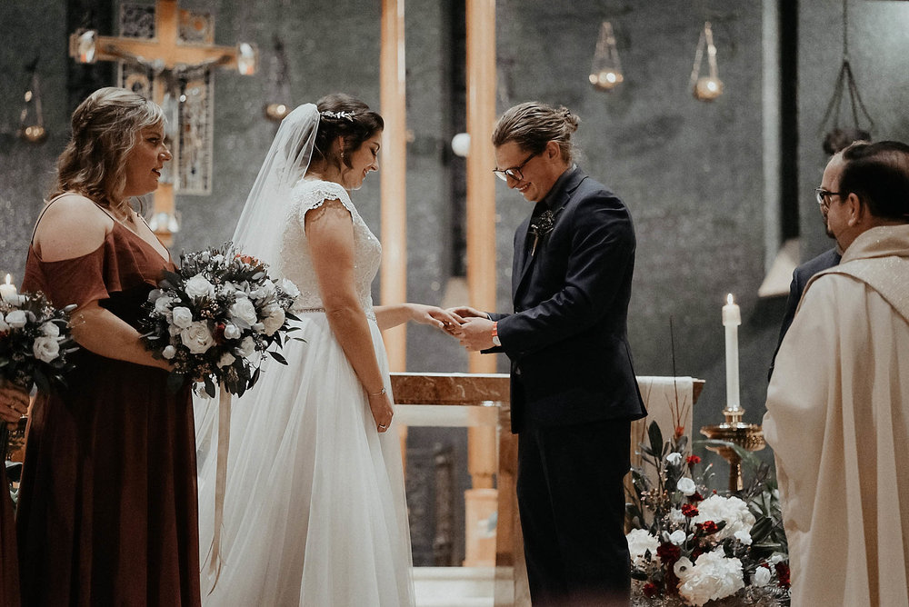 cincinnati warehouse wedding photographer cathedral church ceremony putting on ring
