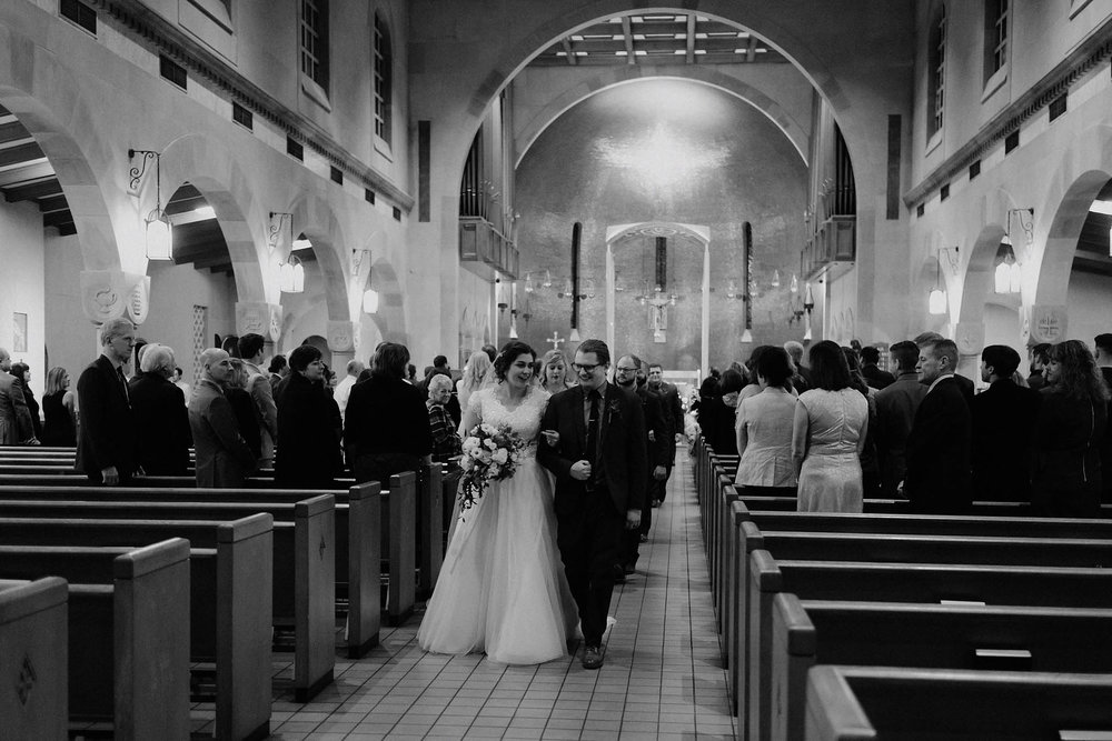 cincinnati warehouse wedding photographer cathedral church ceremony bride groom walking down aisle recession