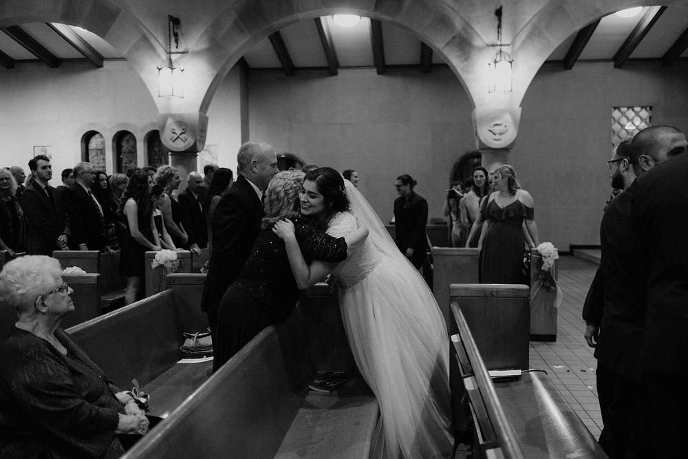 cincinnati warehouse wedding photographer cathedral church ceremony bride hugging