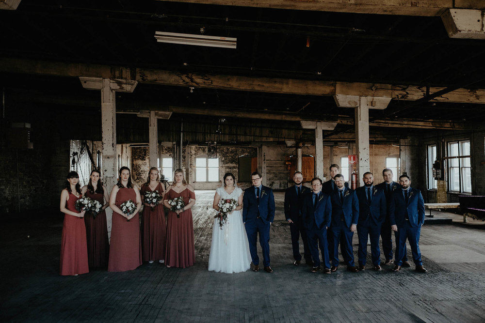 cincinnati warehouse wedding photographer bride and groom group photo