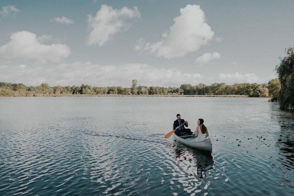 intimate wedding adventure elopement michigan lake couple canoe photo