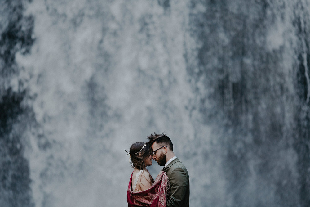 intimate wedding adventure elopement photographer asheville north carolina waterfall looking glass falls couple portrait