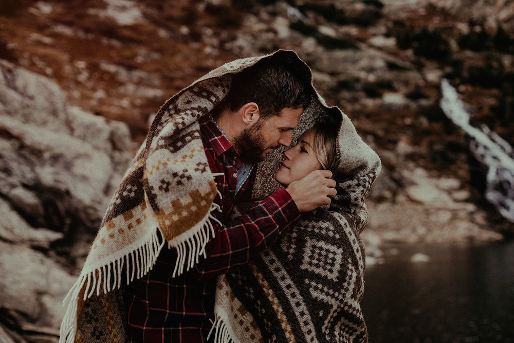adventure session rocky mountains colorado couple photo waterfall blanket intimate