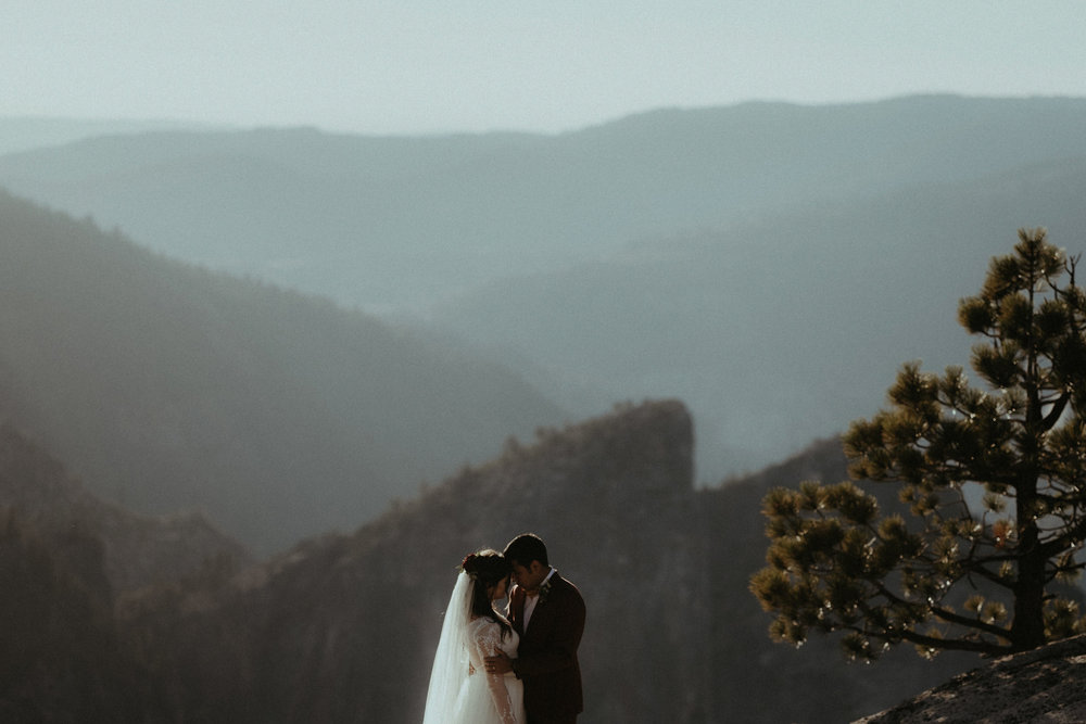 Hannah & Stephon: Yosemite Adventure Elopement - Sincerity is taken to wild new heights on a ridiculous cliff. A heart-warming groom sheds a tear. Mother Nature shows off.