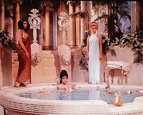 Elizabeth Taylor as Cleopatra in the 1963 film by the same name. Bathing never looked so glamorous!