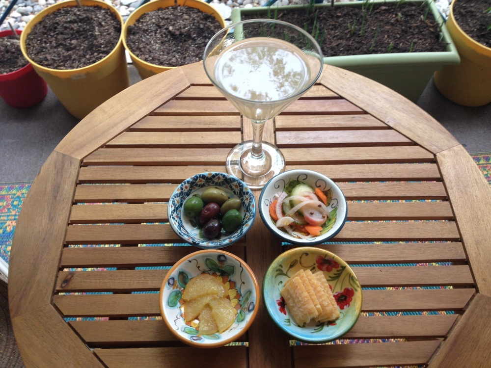 A gin gimlet with, going clockwise, mixed olives, pickled veggies, aged gouda, and salt cured lemons--perfect for some patio apertivo!  The small apertivo plates are from an amazing ceramicist in a small town in the heart of Tuscany, called Certaldo.