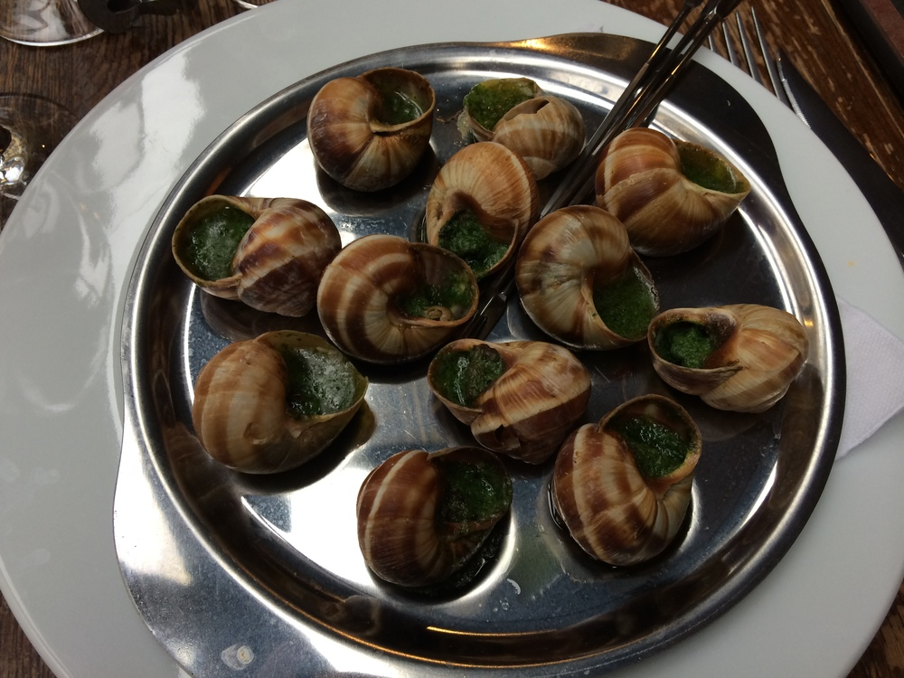 Escargot (snails) cooked in butter and parsley.
