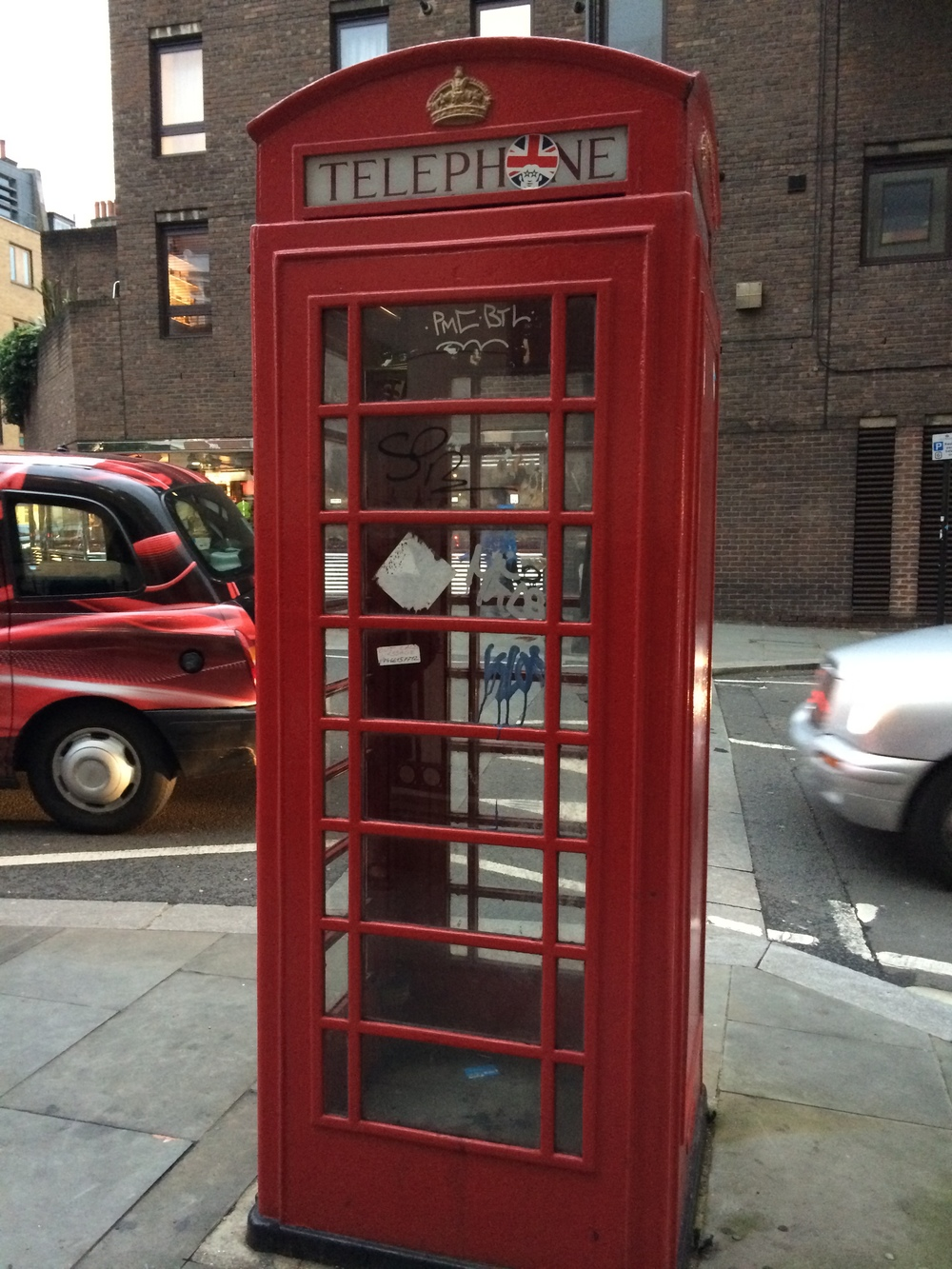 This iconic London telephone booth, complete with graffiti!