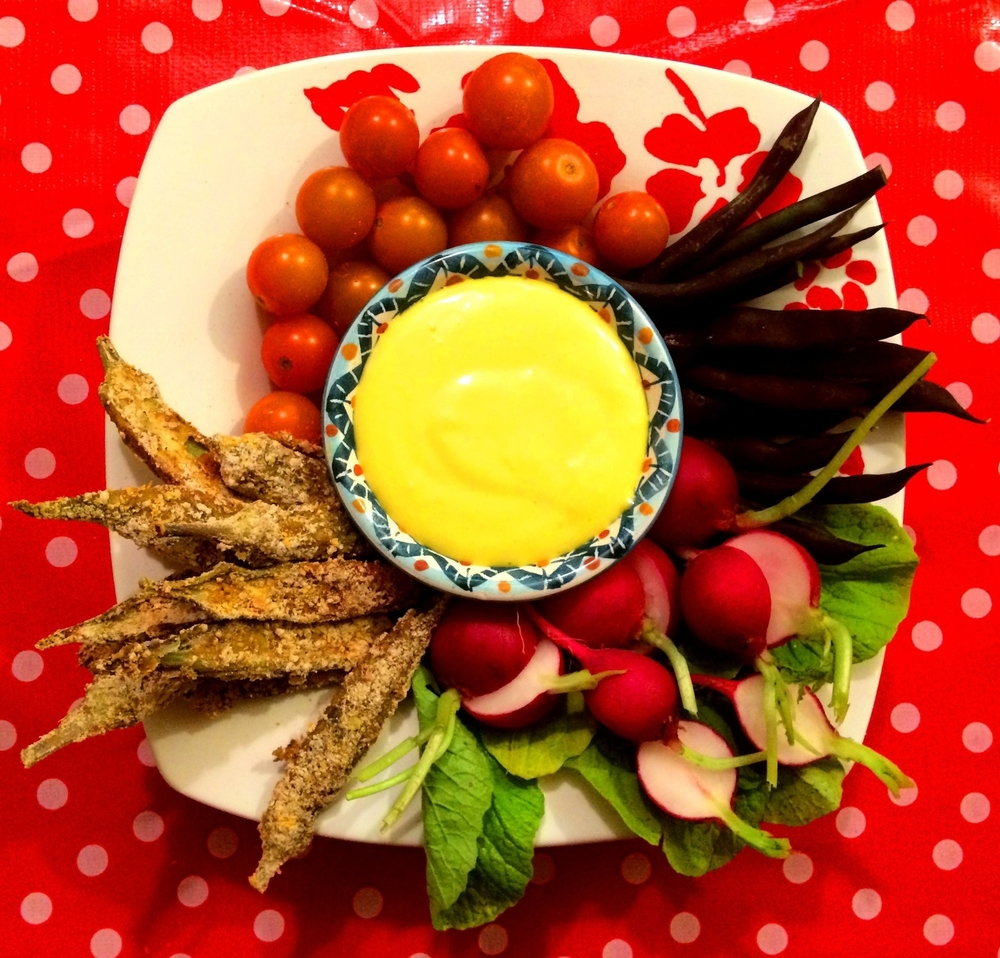 Aioli with cherry tomatoes, purple beans, radishes, and okra fries.