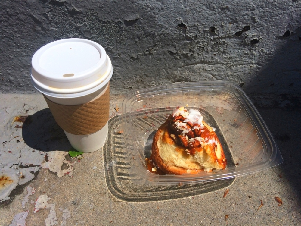 Enjoying a delicious cinnamon roll from Baked in Brooklyn on the stoop.