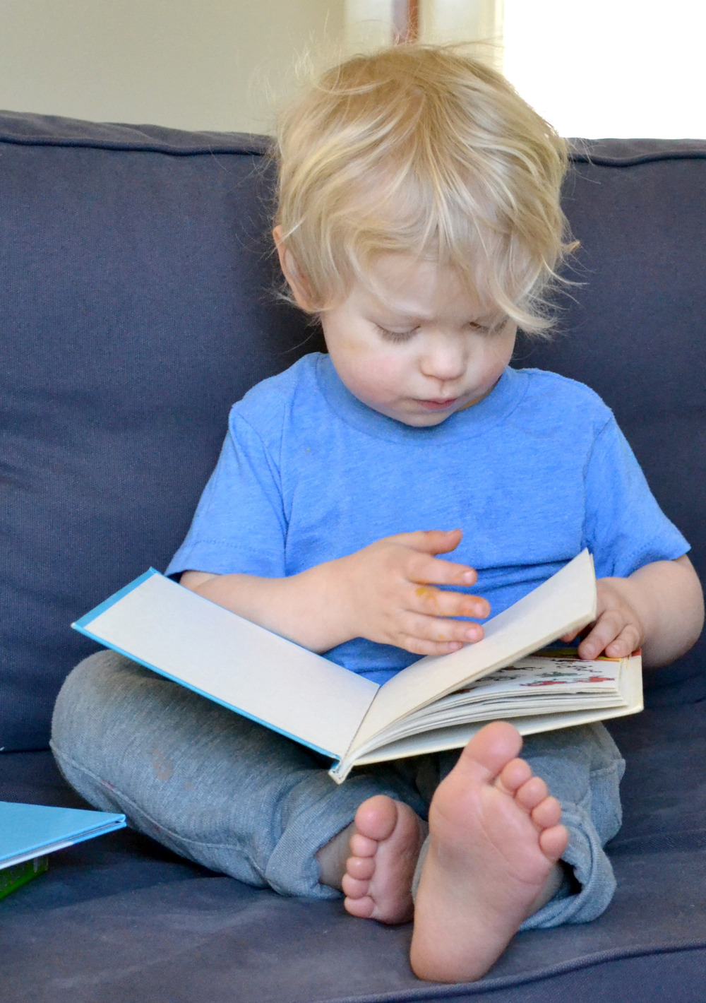 This was one of the first shots I have taken in awhile, his cheeks weren't bright red. My happy little reader!