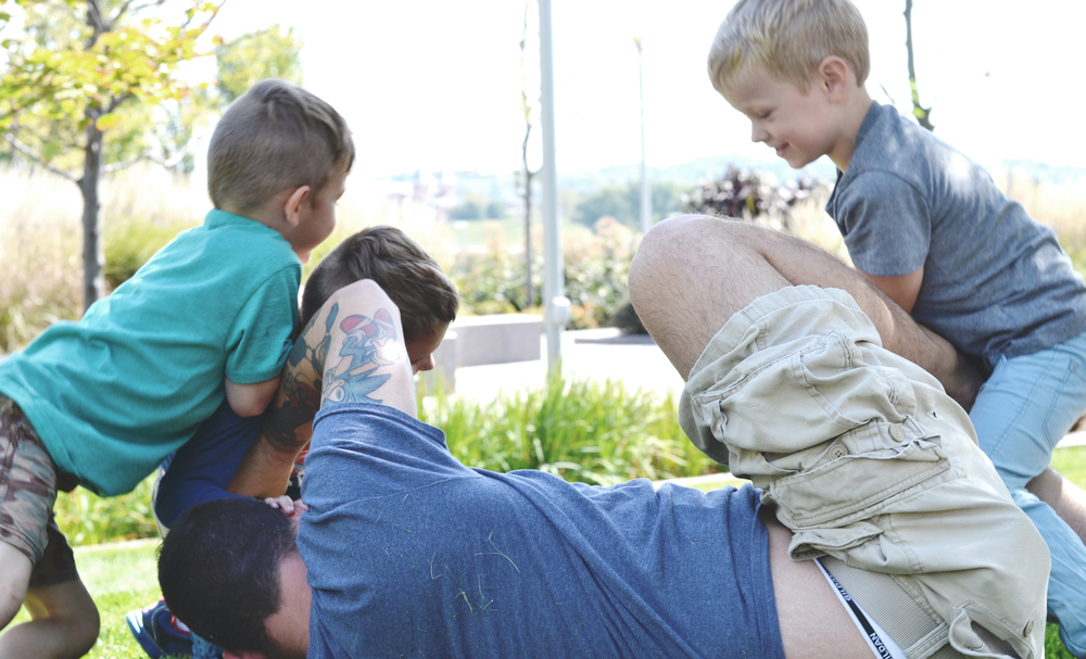 no need for a gym membership when you are 'daddy playground' to three five-year-old boys.
