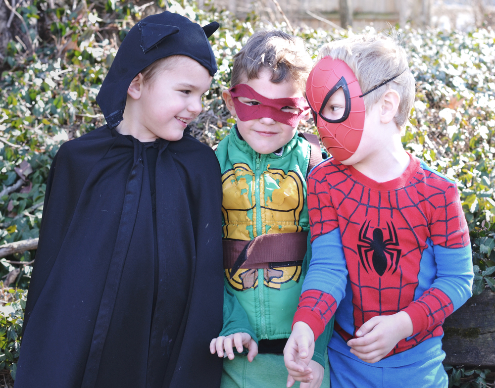 Cheesy smiles and maniacal laughter.  It was a costume concert - Mayer as Batman (vintage - OG!), Marley as Raphael and Soren as Spiderman (he's a little obsessed...)