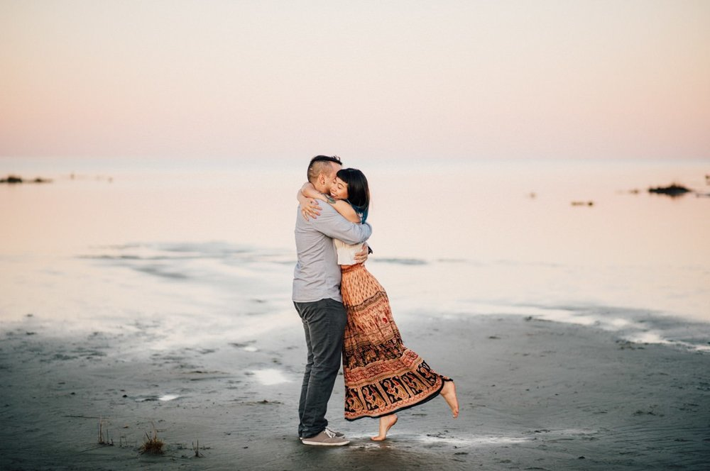 couple hugging on a beach