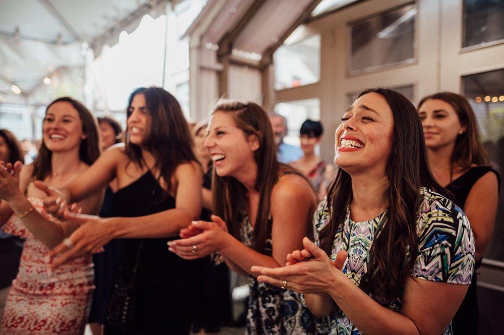 guests laughing at Toronto wedding