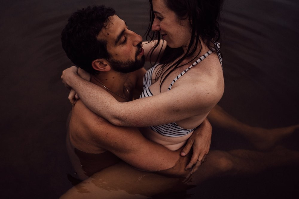 Couple hugging in lake