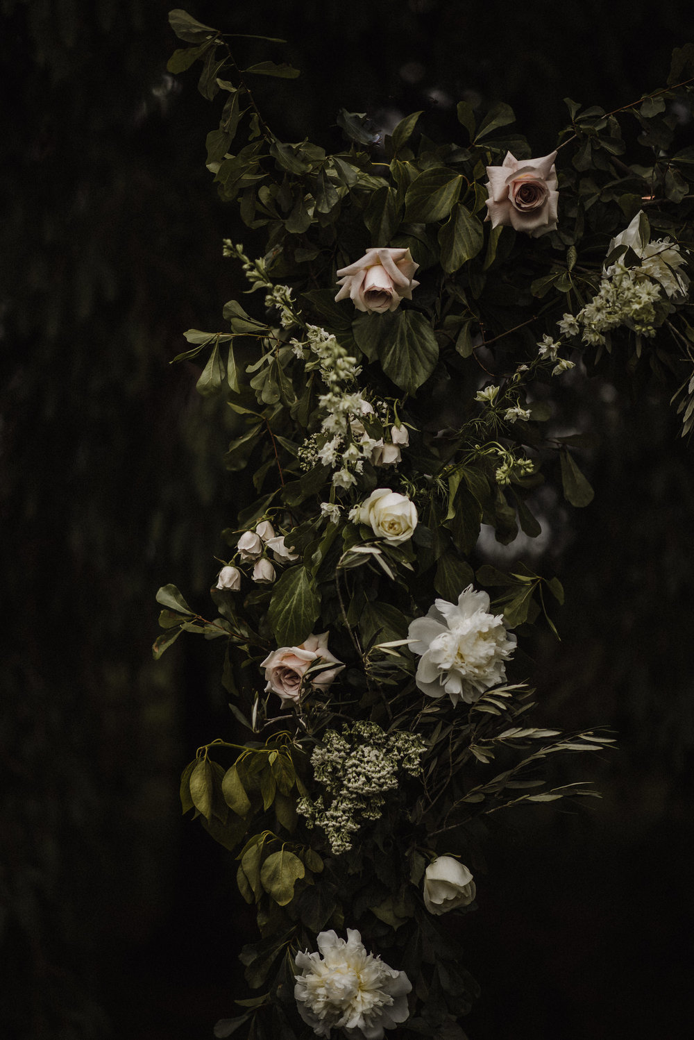 moody ceremony floral backdrop