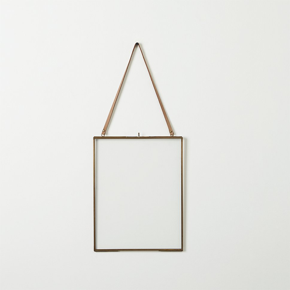 Brass Floating 8x10 Picture Frame via CB2 ($39.95)