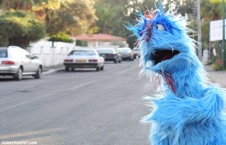 professional_furry_blue_puppet_with_blinking_eyelids.jpg