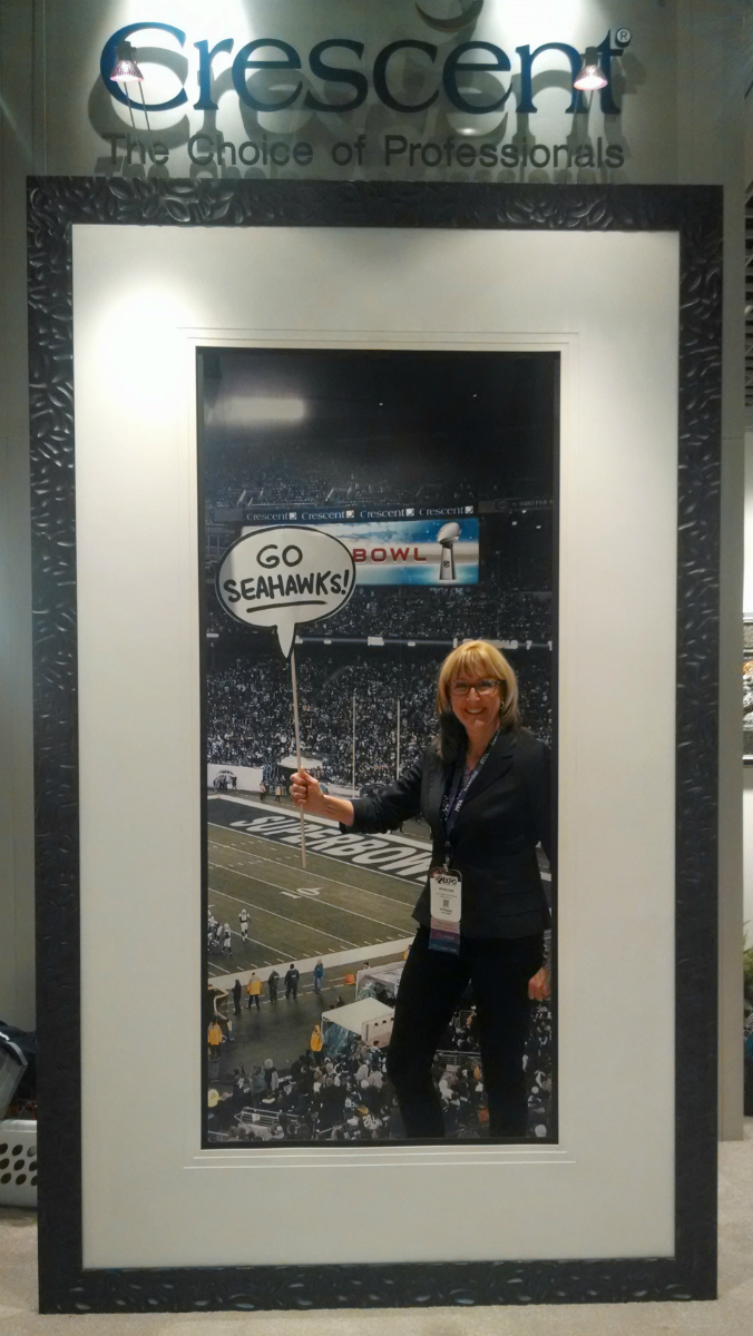 Myrna Dow cheering for the Seattle Seahawks at the West Coast Art and Frame Expo 2015.