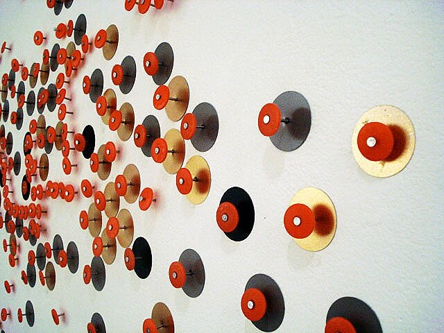 Orange: Crime Dots, 2012, installation view, tin/plastic discs, spray paint and nails