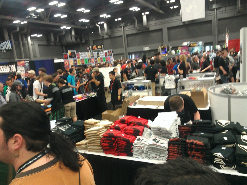 The Rooster Teeth merch booth at the center of the hall.