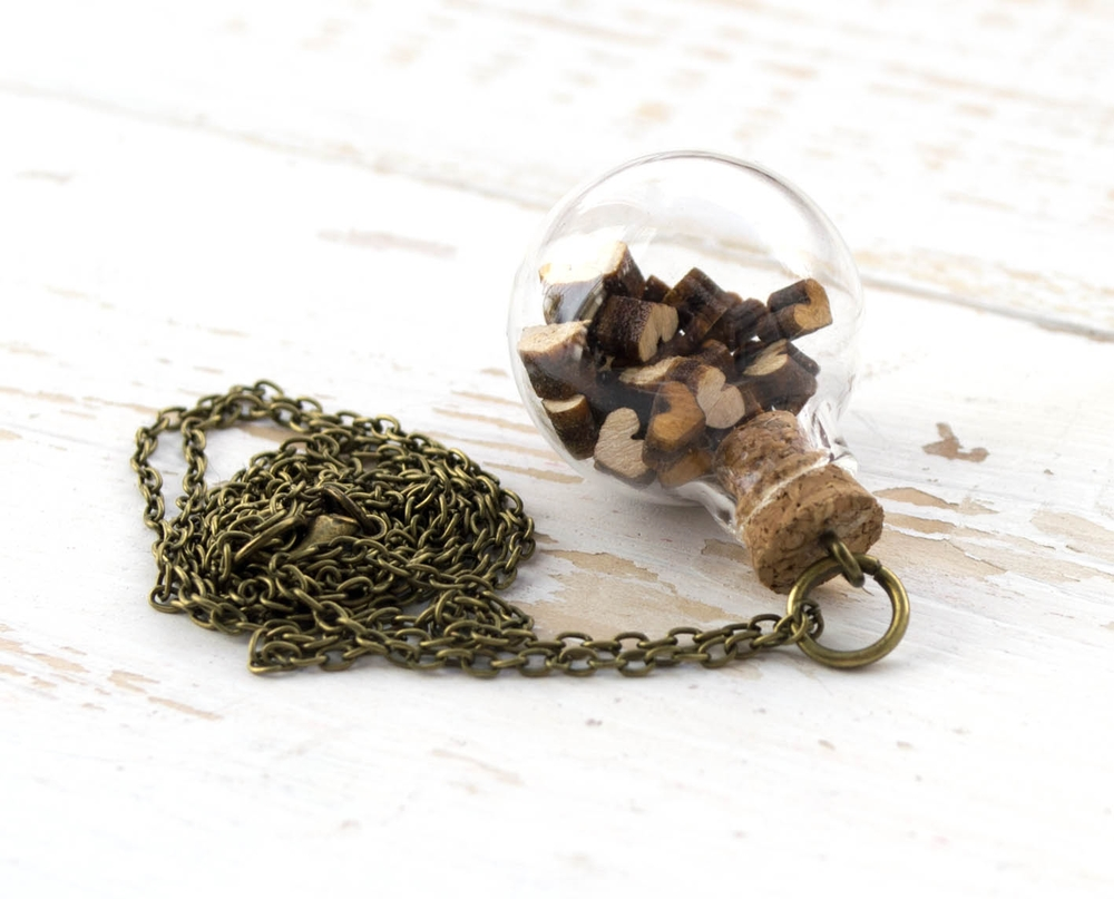 Glass bulb with tiny laser cut wooden hearts inside