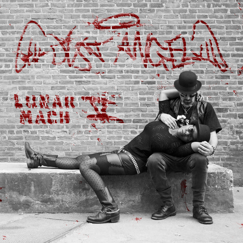 """DUST ANGEL'S EP 'LUNAR MACH V' IS DIGITALLY AVAILABLE EVERYWHERE:https://itunes.apple.com/us/album/lunar-mach-v-ep/id878194760 Lunar Mach V is an E.P. that contains five songs from the upcoming conceptual L.P.""""The Life & Times of Stig Rotsky Revisited""""; which is loosely based on the life of the guitar player's previous band's lead singer. The first track on the E.P., """"Love Is Between My Legs"""", is a down and dirty rocker about free love, but for punk rockers and everyone else alike. It's followed by a 70's Hard Rock anthem, """"Lucky 7"""" whose lyrics expose the drug culture in America. The 3rd song """"In The Thirsty Hour"""" is one of their fastest songs, in the tradition of Heavy Metal Thrash, which deals with the disease of addiction. The fourth song on the E.P. called """"Temptress"""" is a simple three chord Pop song where the basses (a 12 string bass is utilized to modulate the main melody) are paramount to this song about the world's oldest profession. The E.P. ends with another fast Heavy Metal song """"Necrophilia"""" about the life of a serial killer."""