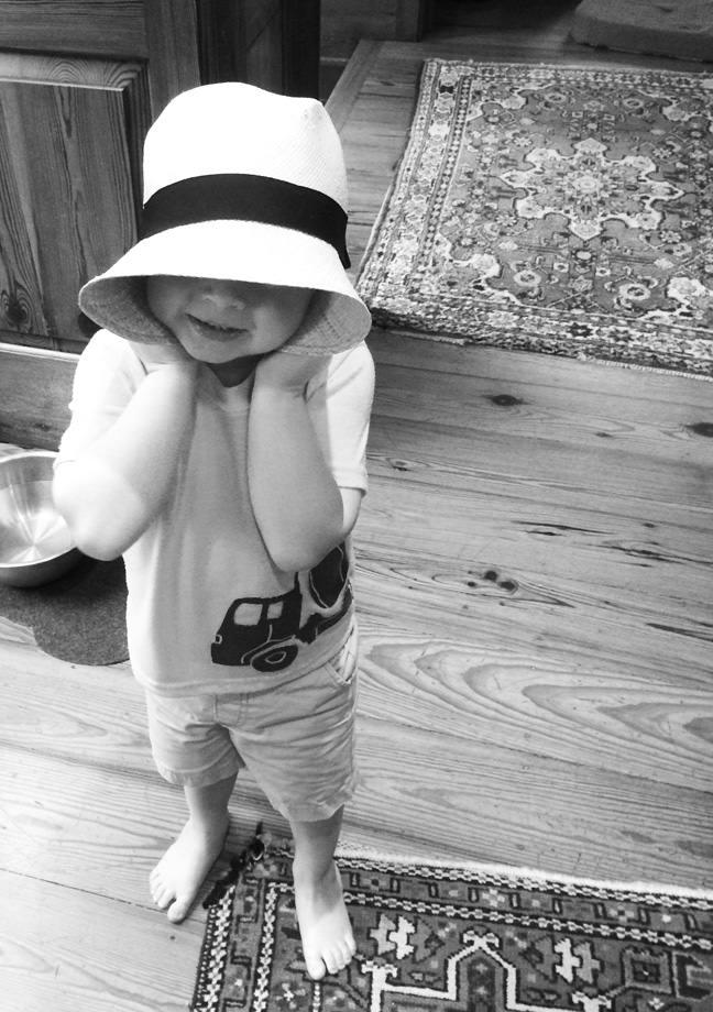 Modeling Aunt Wachel's hat.