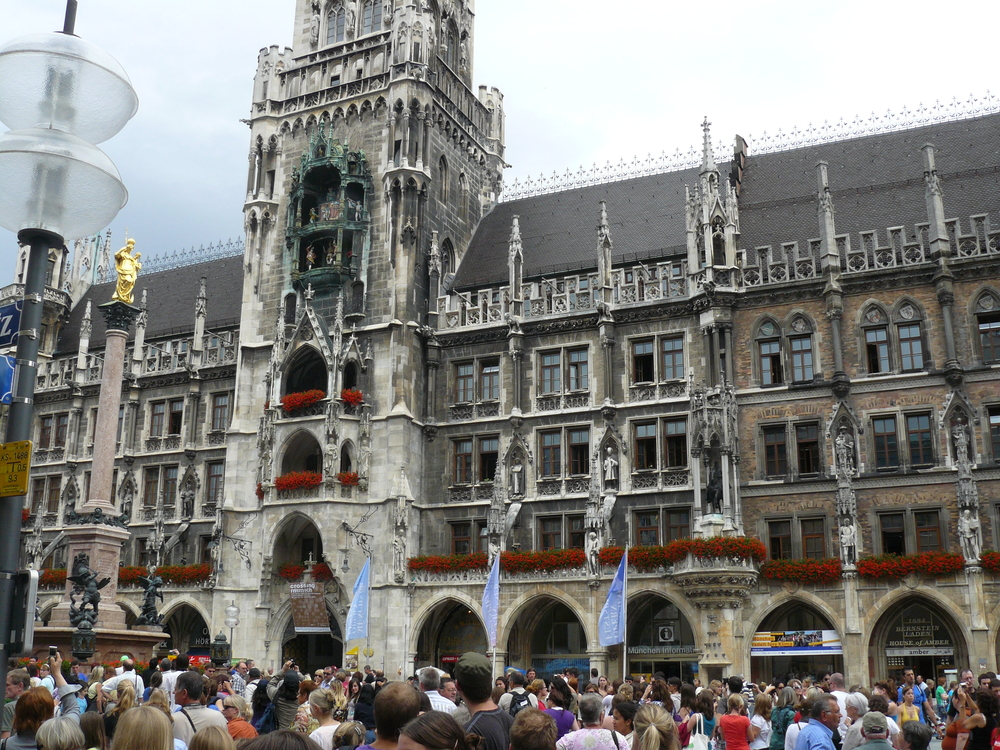 Exploring Munich. The clock is about to sound, sending statues marching across the balconies!