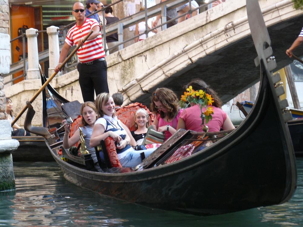 Enjoying a gondola ride through the narrow canals in Venice.