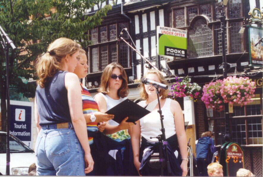 A quartet from the choir performs at the Market Square.