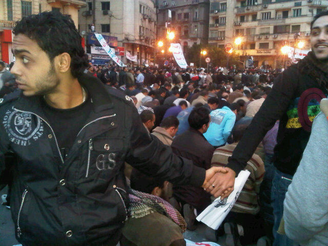 Photo: Nevine Zaki, Christians protecting Muslims during prayer in Tahrir Square