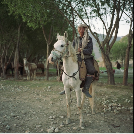 A Kyrgyz horseman prepares to check on his herd of sheep and goats outside the village of Ghaz Khan. The Pamir Kyrgyz live at high elevations on the Pamir Mountains and leave only during the spring and summer months.