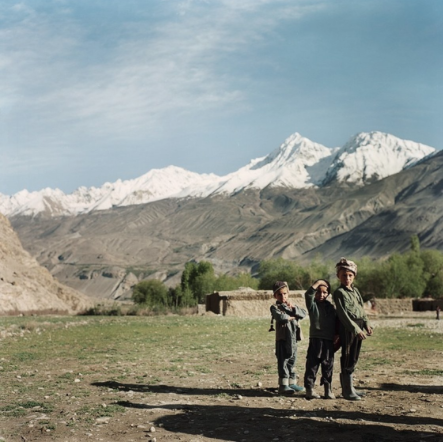 Boys take a break from playing in the village of Ghaz Khan. Schooling is accessible in most villages, making this new generation the first to benefit from widespread education.