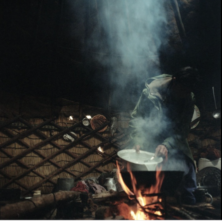 A Wahki shepherd boils goats milk inside of the yurt that he shares with three other men.
