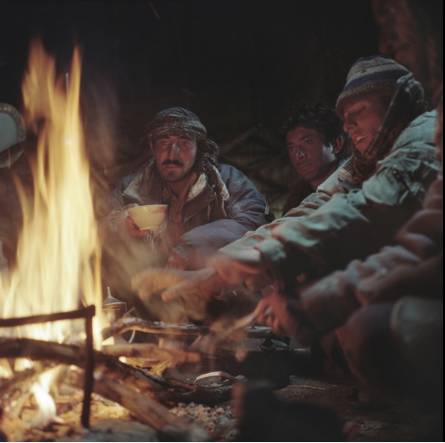 Wakhi shepherds and horsemen warm themselves by a fire in their yurt in the Wakhan Corridor.
