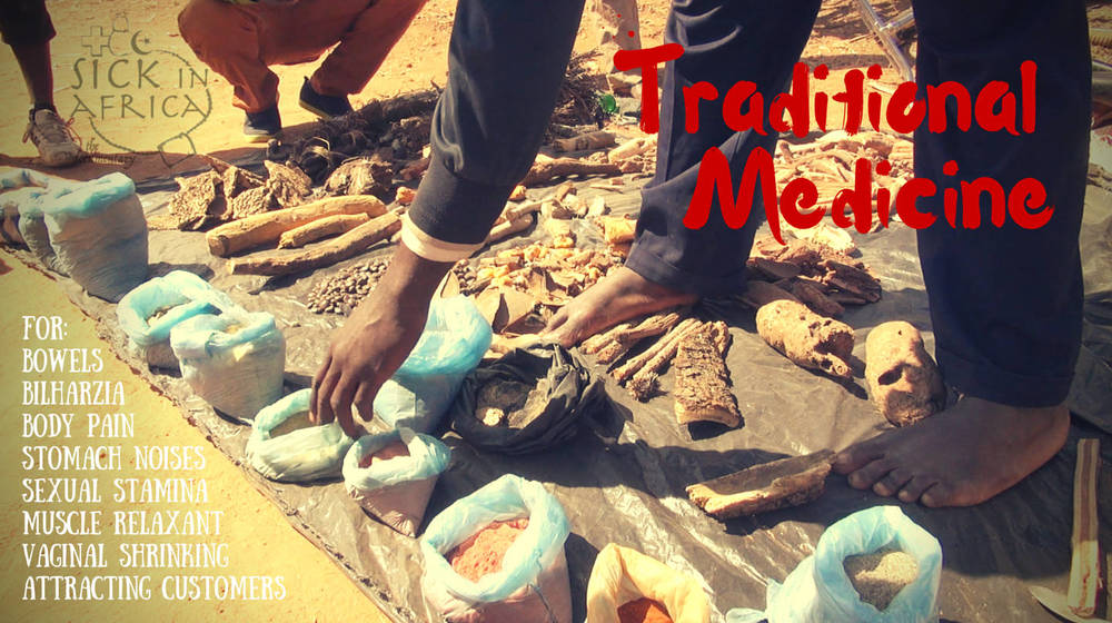adamu shows some of the traditional medicine he offers for sale at the market to help with various ailments